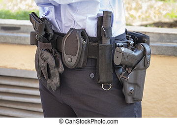 police belt - a police officer standing in the street next...