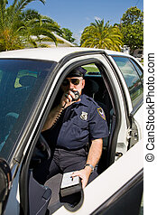 Police - Calling In Tag - Police officer in his car calling...