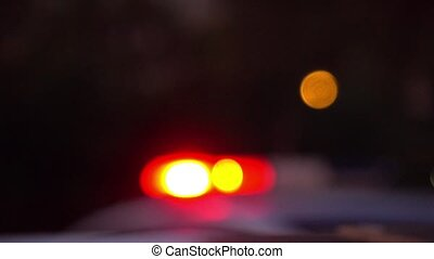 Police car flashing lights at night 4K bokeh blurred shot