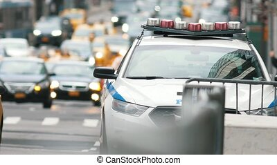 Police car in manhattan - NYPD on crowded avenue, telephoto
