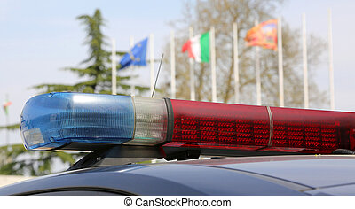 police car with Italian flags on background