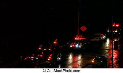 Police cars at night - Police cars line up on street at...