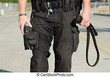 A close up of a police K9 handler's duty equipment.