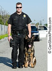 Police Dog - A K9 police officer with his dog.