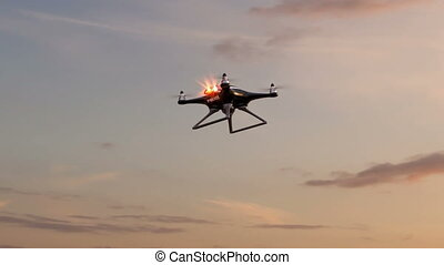 Police drone flies against sky background - Police drone...