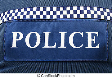 Police Forces - Close-up of police logo on policeman uniform...