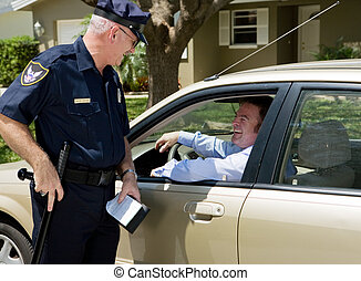 Police officer having a laugh with the guy he just pulled over.