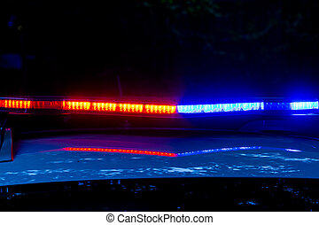 Police lights flashing on the to of car