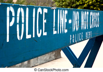 """Police line - Do not cross - Police barrier saying \""""POLICE..."""