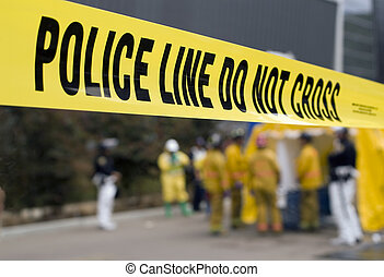 Police Line-HazMat - A police line in front of a HazMat...