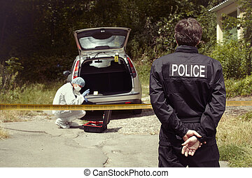 Police man and technician exploring abandoned car -...