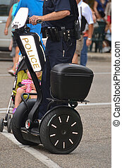 Police officer patrolling a city street on a segway