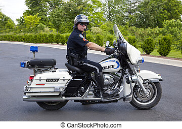 Police officer on his police motorcycle going to work radar to slow speeders down