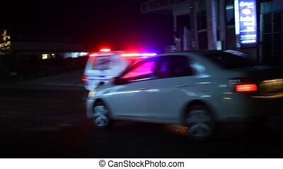 Police of cars rides on the night road with siren. have a...