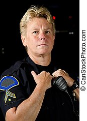Police Officer - a serious looking female police officer...