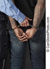 police officer arrested a criminal - Close up image of...