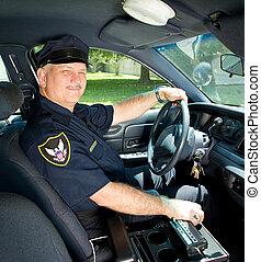 Police Officer Drives Squad Car - Handsome mature police...