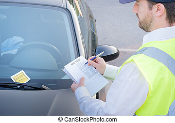 Police officer giving a fine for parking violation - Police ...