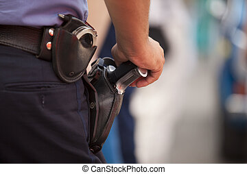 police officer - Police ffficer stand with handgun on his...