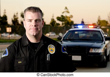 Police officer - A police officer standing in front of his...