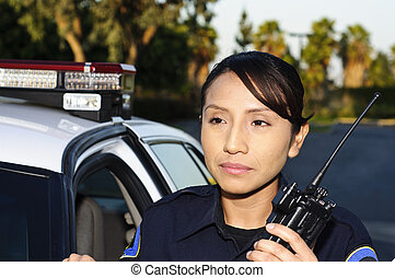 police officer - a female police officer standing next to...