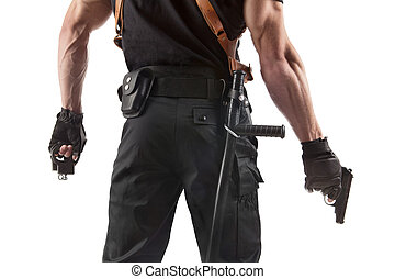 Police officer with handcuffs and gun - Unrecognizable ...