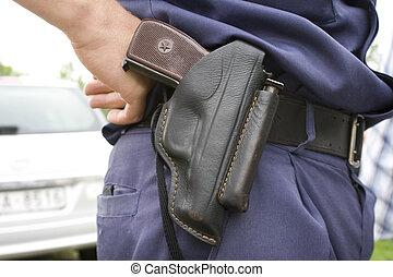 Police officer`s holsten with gun.
