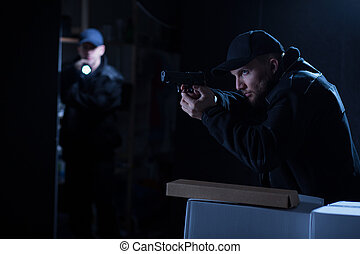 Police officers in action - Image of two police officers in...