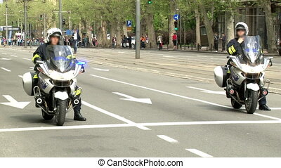 Police officers on a motorcycles - Two officers on a...