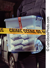 Police packing lot of drugs found in car near river under...