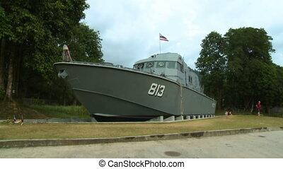 Police Patrol Boat on Land - Steady, medium wide shot of a...