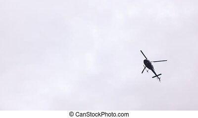 Police patrol helicopter - In flight over the city police...