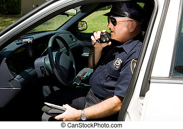 Police - Radioing In - Police officer in squad car, radioing...
