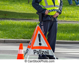 police roadblock - a road is blocked in a police operation.