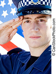 police salute - a police officer saluting in uniform in...