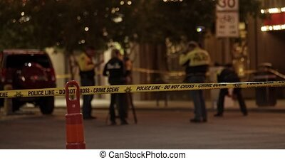 Police tape across a street at an urban crime scene - Slow ...