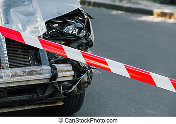 Police tape on road in front of car accident. Crashed Suv car in road traffic accident. Cars collision due to drunk driving, auto insurance, fatal accident