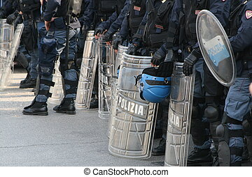 police with shields and helmets during a riot in defense of...
