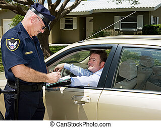 Police officer writing a traffic citation while an unfortunate driver looks on from his car.