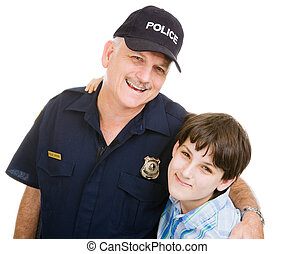 Policeman and Boy - Friendly police officer and an...