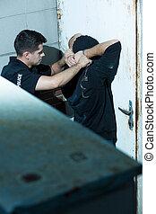 Policeman arresting kidnapper