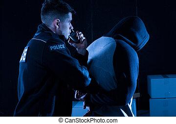 Policeman arresting law-breaker