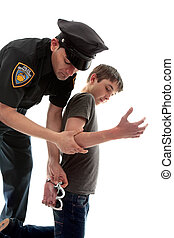 Policeman arresting teen criminal - A uniformed policeman...
