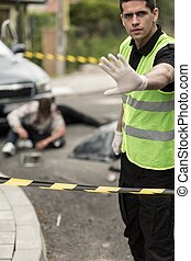 Policeman at car accident area