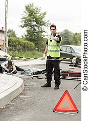 Policeman at road accident scene - Vertical view of ...