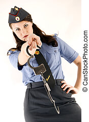 Policeman close-up - Young woman in police uniform holding...