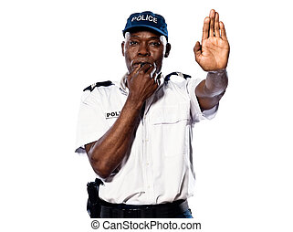 Policeman gesturing to stop and whistling - Portrait of an...