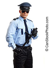 Policeman hold nightstick - Policeman in uniform holds at...