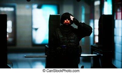 policeman in empty underground metro sunbway