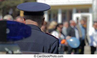 policeman  in the crowd